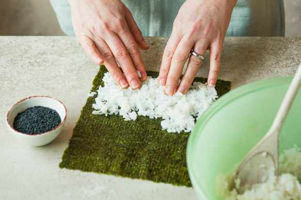 Step 2: Spreading rice over a sheet of nori.