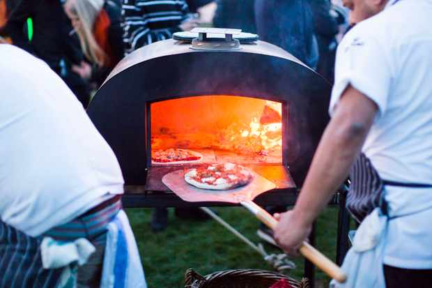 Pizzas cooking in a pizza oven at Bristol Food Connections