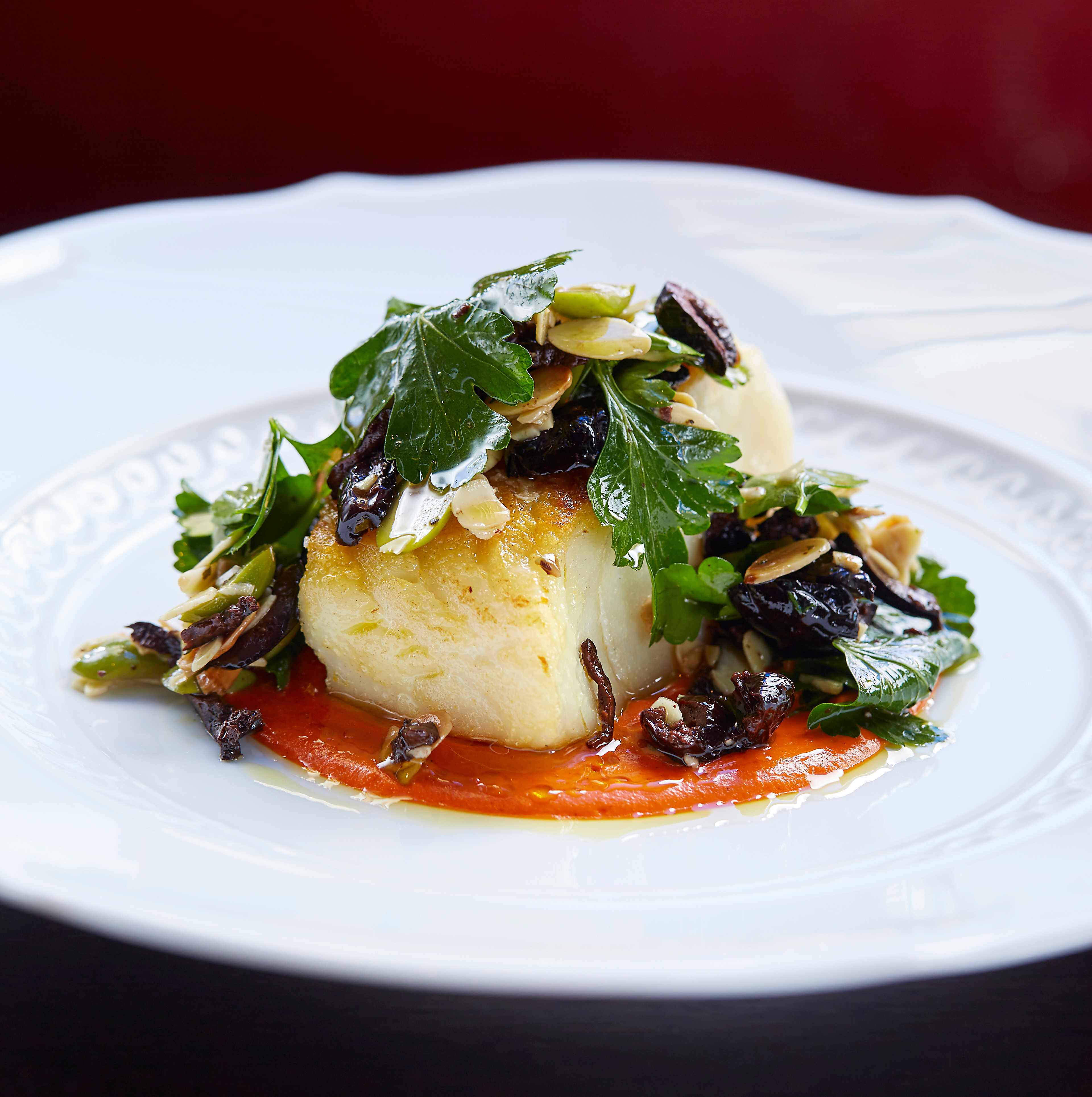 Roasted cod & romesco sauce with olive and almond dressing