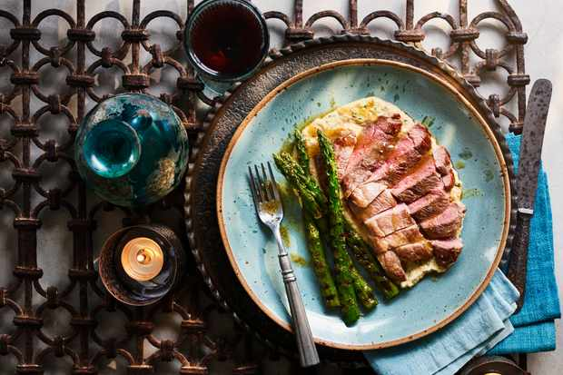 Lamb steaks with yeast butter and warm hummus