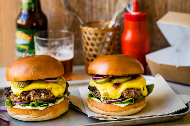 Smashed burgers with jalapeño rarebit