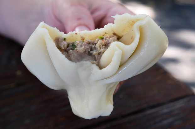 A large meat-filled khinkali dumpling