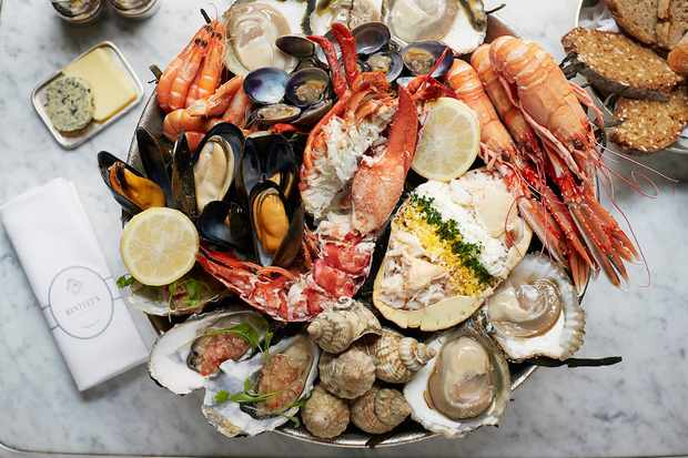 An impressive seafood platter filled with oysters, mussels and crayfish