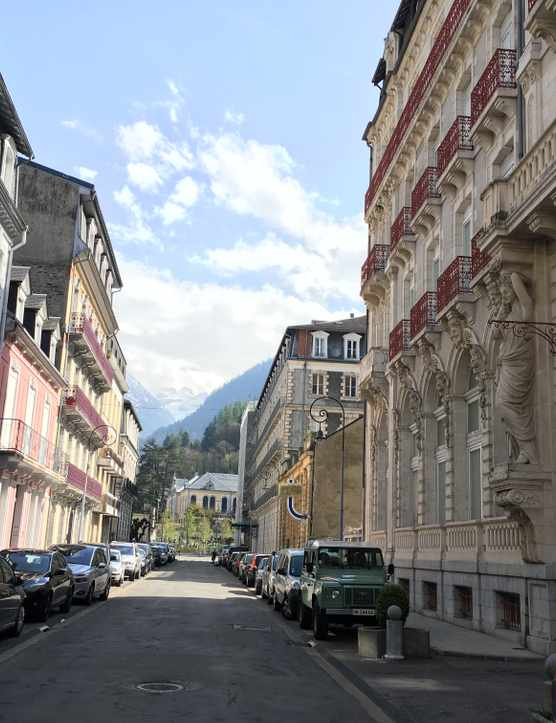 Pastel building and the view of mountains in Cauterets