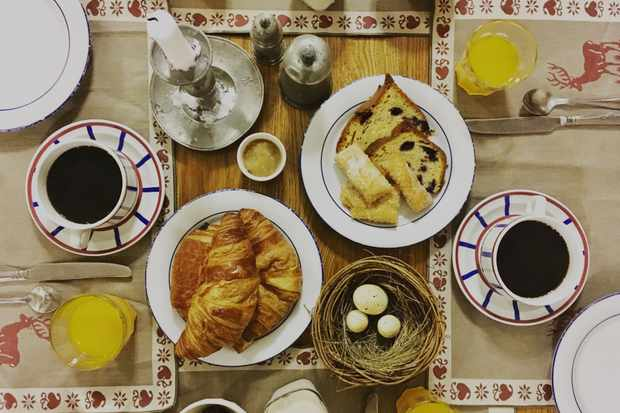 Breakfast of croissants, juice, pastry and coffee at lion d'or hotel