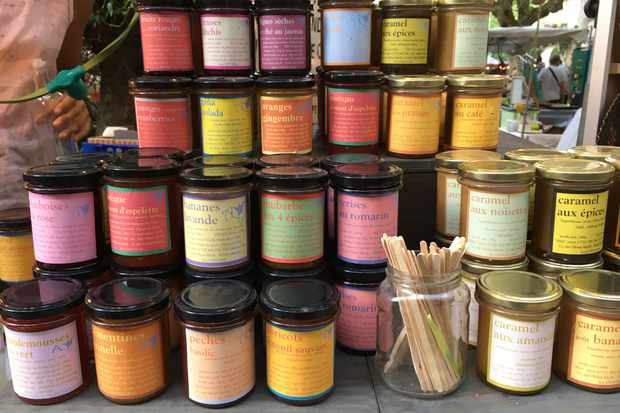 A variety of jams and caramels at a local market