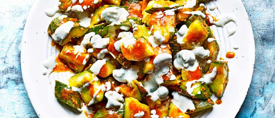 Chopped cucumbers with homemade buffalo sauce and blue cheese