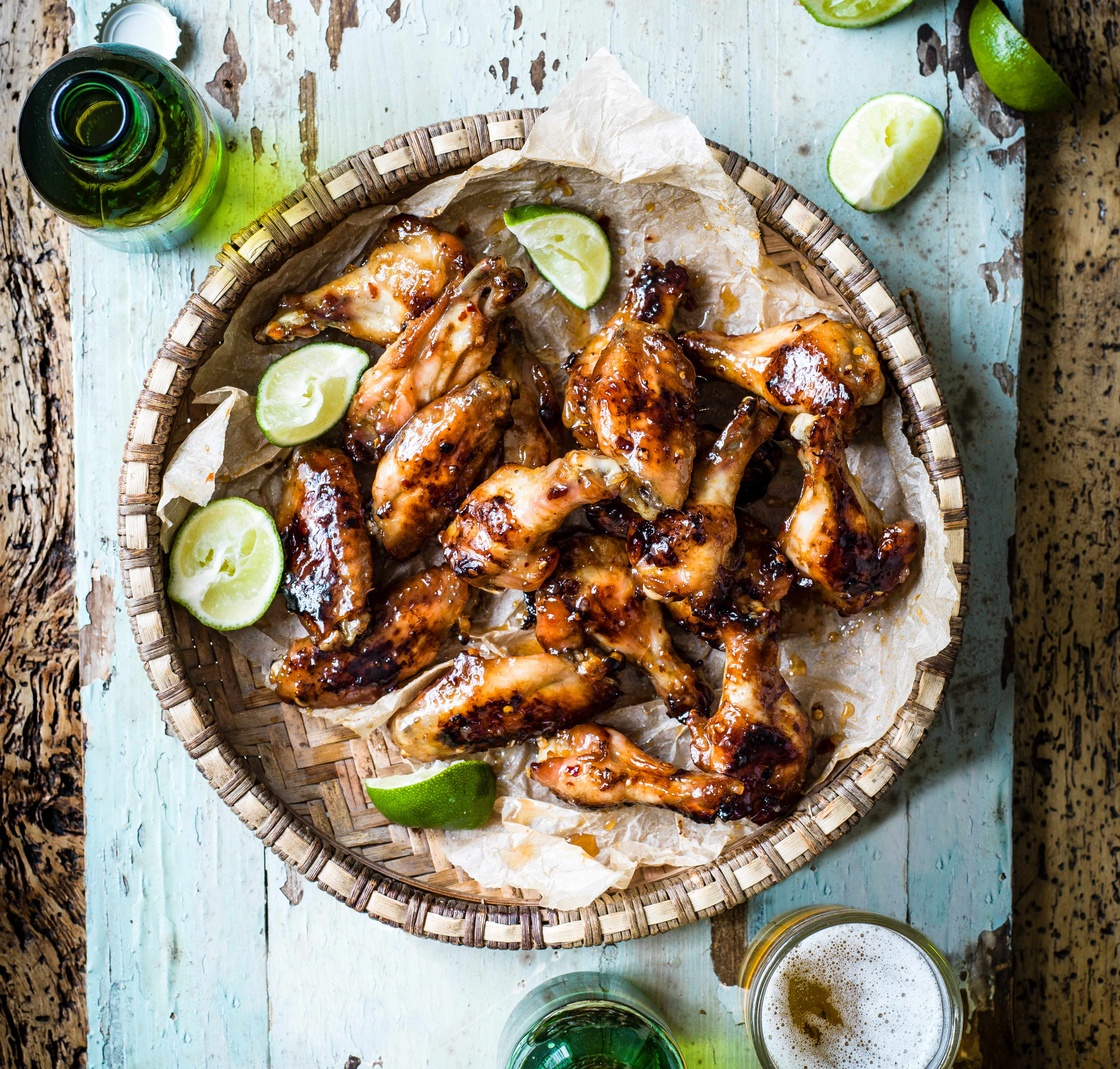 BBQ Fish sauce wings - sticky bowl of mini wings with lime wedges