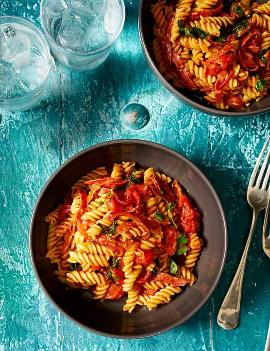 Gluten-free fusilli with salami and cherry tomatoes