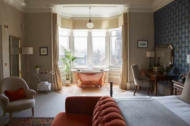 Bedroom with a copper freestanding style bath at The Dunstane Houses, Edinburgh