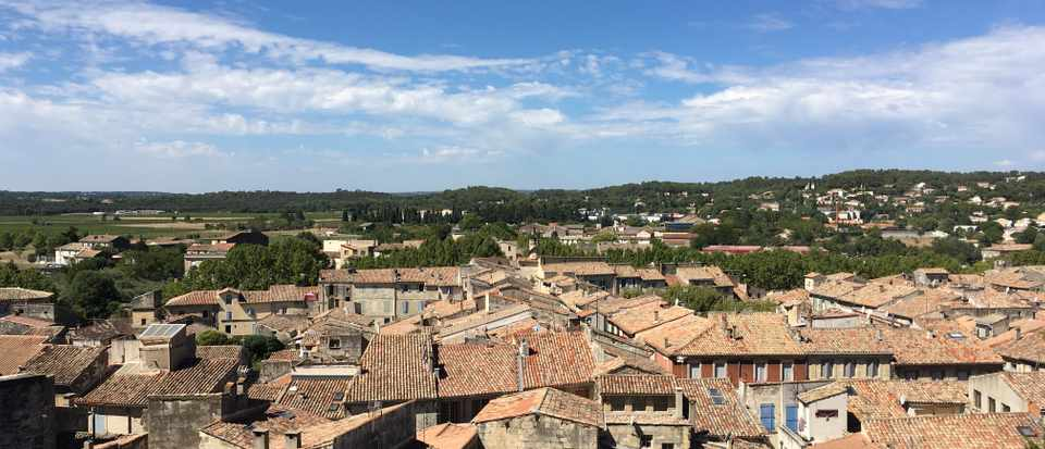 Sommieres rooftops and bright blue sky