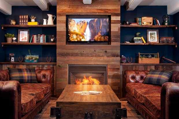 Basecamp Lobby with wooden table, leather sofas and books