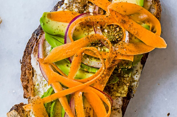 California avo toast with sliced carrot and red onion