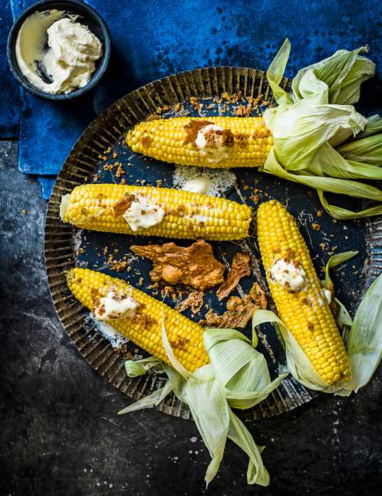 Corn-on-the-cob with whipped chicken fat and chicken skin salt