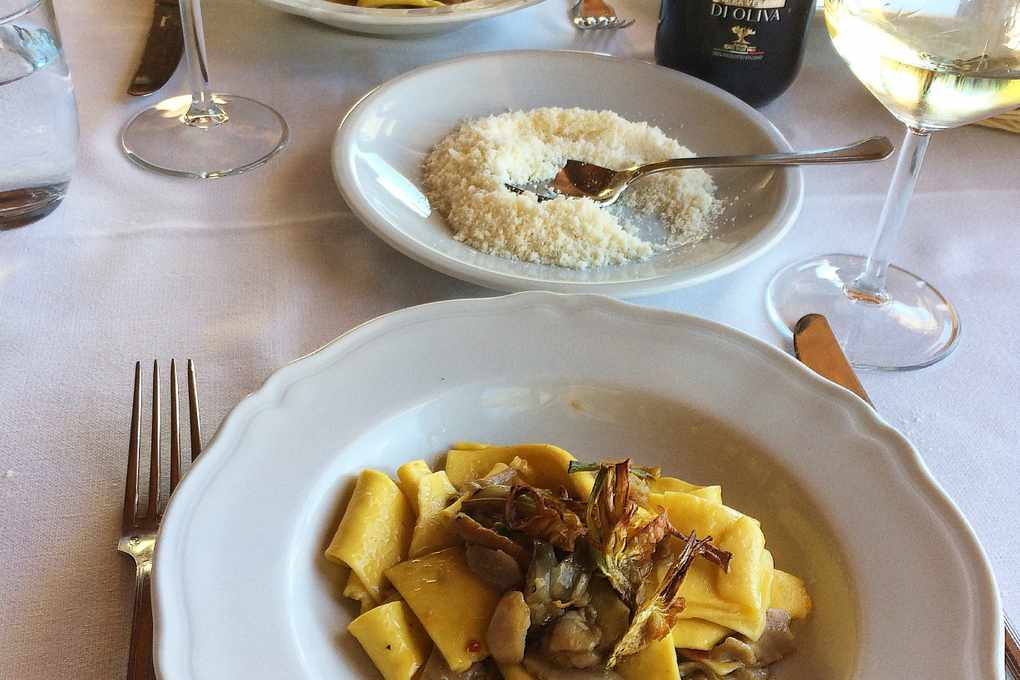 Pasta dish with parmesan on the side at Taverna di le Caldora Pacentro Italy