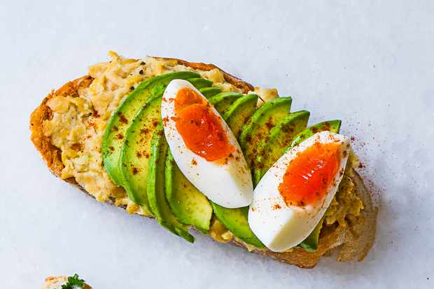 Moroccan avo toast with sliced boiled egg