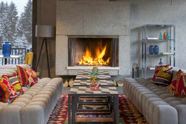 Terminal Neige Totem - a roaring fire with cosy sofas
