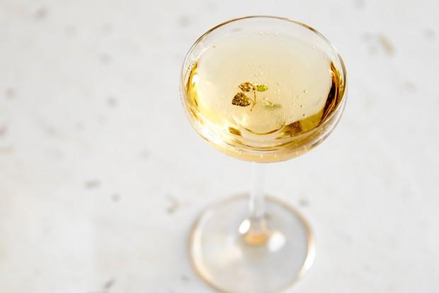 Coupette glass of light amber liquid