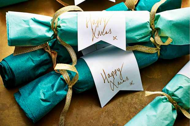 Turquoise paper Christmas crackers with white tags