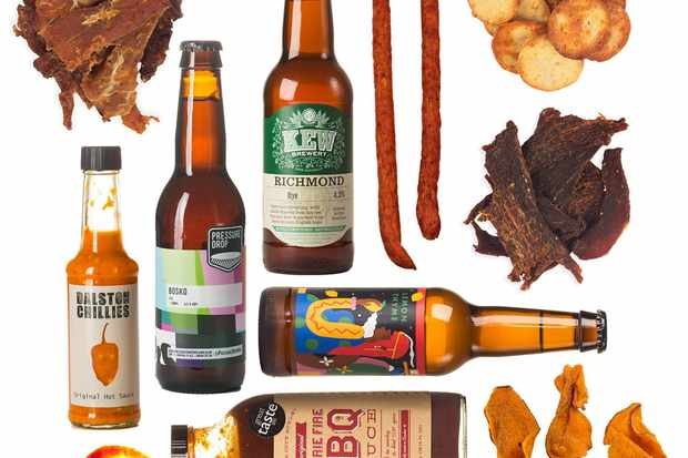 A layout of products from the beer meat hot box - bottles of beer and crisps