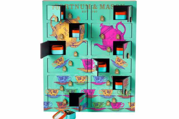 Fortnum and Mason Rare Tea Wooden Advent Calendar. The calendar is in a teal colour and has coloured teapots on the front of it