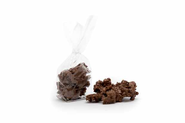 A clear packed is filled with a few GAIL's Sourdough Breadcrumb Chocolate Clusters. There a couple of clusters next to the bag, too