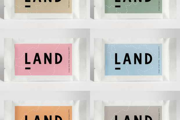 """A selection of LAND mini chocolate bars. There are six bars in the picture all with a label that says """"LAND"""""""