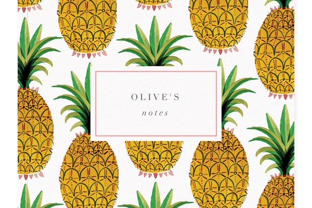 A notebook covered in yellow pineapples with a white box at the top which says olive notes