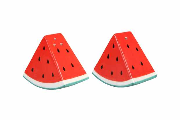 One salt and one pepper shaker shaped like watermelons. They are red with black spots and a white trim around the bottom