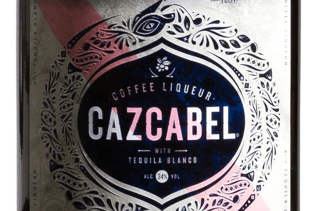 A bottle of coffee cascabel liquor. The liquor is dark in colour and the label says coffee cazcabel liquor on it