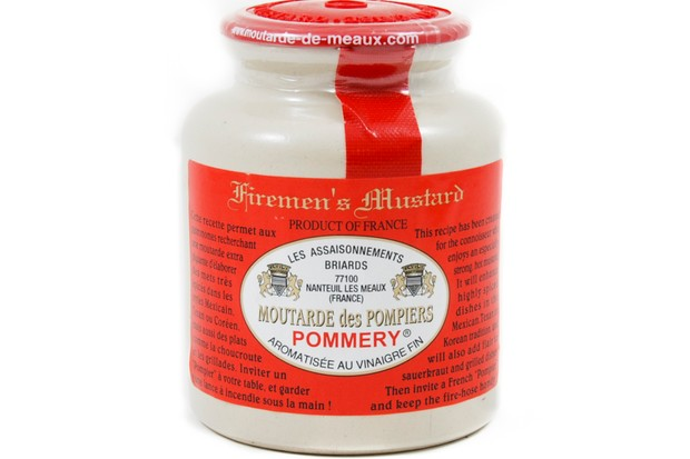 A jar of pommery firemens mustard. The jar has a red lid and a red label around the centre with writing on it