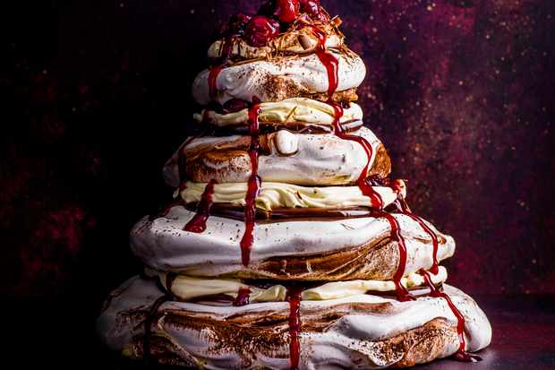 Meringue stack with cream and cherry glaze dripping