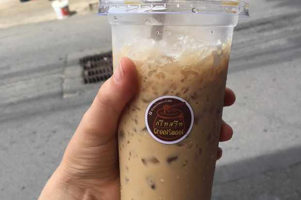 A plastic cup of coffee with lots of crushed ice
