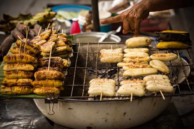 makeshift grill with skewers of small bananas