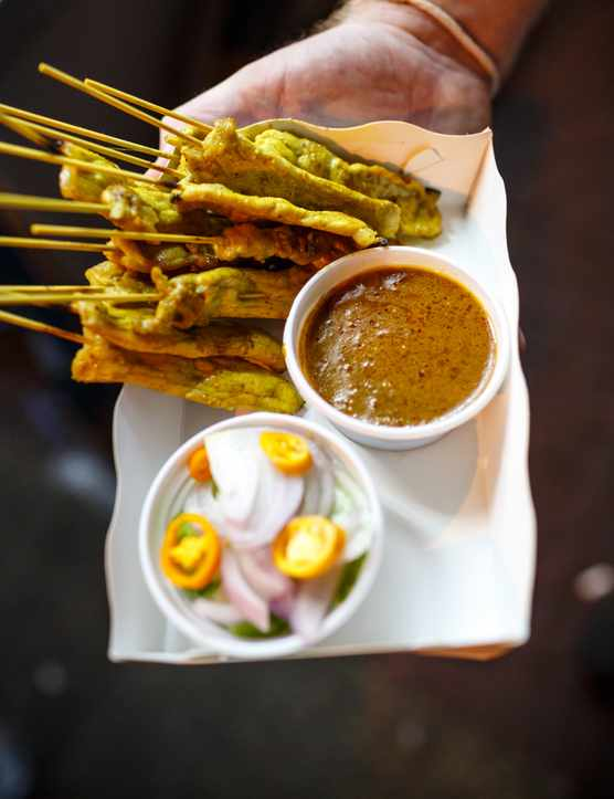 Bangkok Food Guide - Gilled pork on skewers with peanut dipping sauce