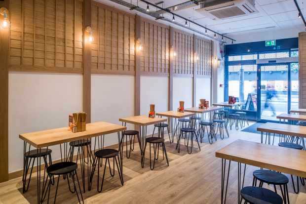 Wooden interiors of a restaurant with tables