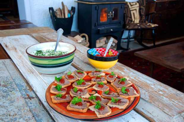 Platter of tartines on a table in front of a log burner