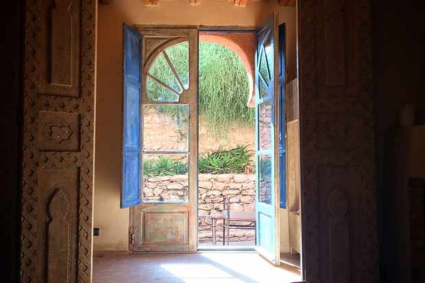 Painted glass doors leading onto a patio