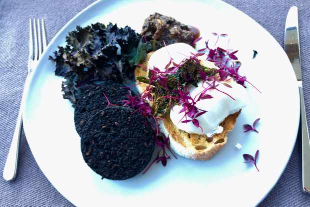 Breakfast - poached eggs, kale, Stornoway black pudding and sourdough