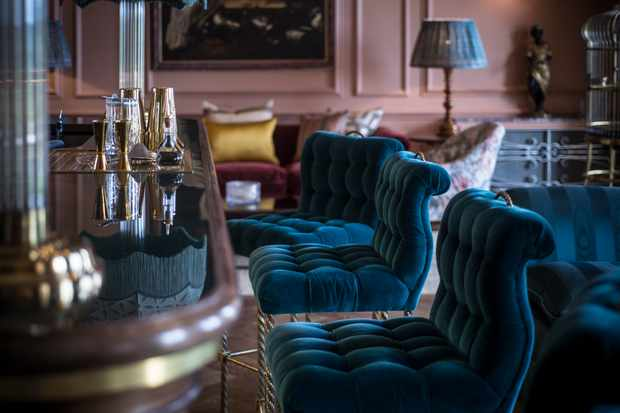 Blue stools next to a bar
