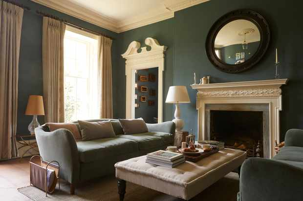 Sofas and a coffee table by a fire in The Rectory Hotel Sitting Room