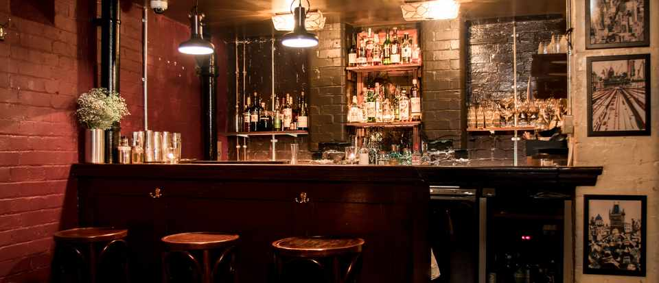 Horatio Street Social Club, Hoxton, London E2: Bar Review. A dark room with low lights and a bar