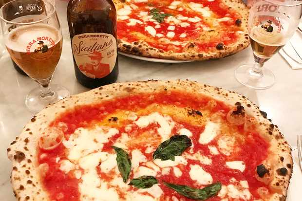 Pizza and a Birra Moretti beer