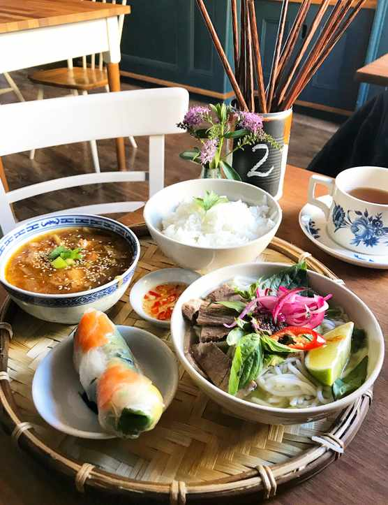 Vietnamese dishes on a bamboo tray