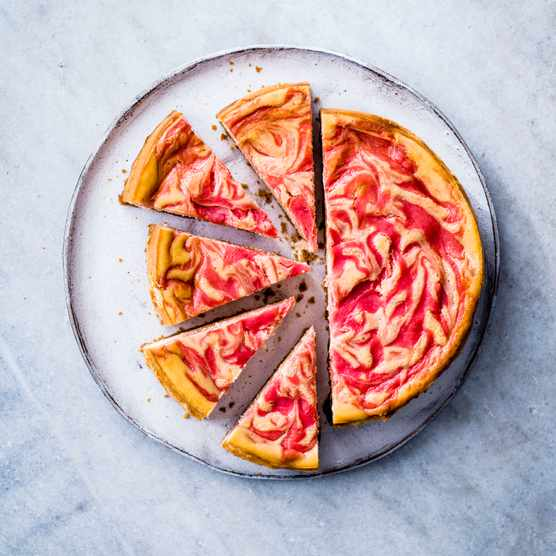 Baked Cheesecake with Rhubarb and Custard cut into slices