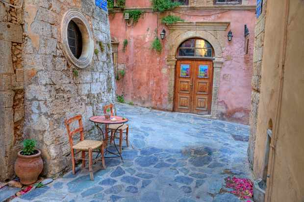 Greece, Greek Isles, Crete, Chania, Old Harbor, Alley Way with doorway.