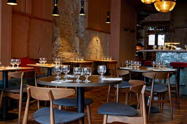 Wooden tables and chairs in restaurant