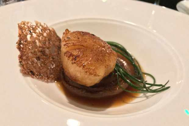 Orkney island scallop with onion dashi, preserved Meyer lemon, rye and Monk's beard