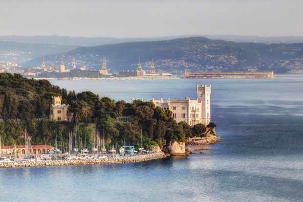 The beautiful Miramare castle with Trieste in the background