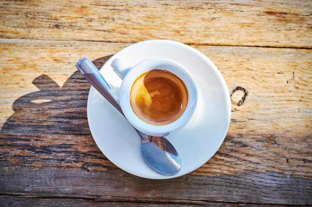 Small espresso cup on a wooden table